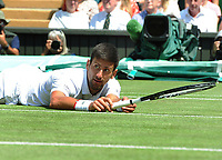 Tennis - 2019 Wimbledon Championships - Week Two, Friday (Day Eleven)<br /> <br /> Men's Singles, Semi-Final: Novak Djokovic (SRB) vs. Roberto Bautista Agut (ESP)<br /> <br /> Djokovic slips on the grass, on Centre Court.<br /> <br /> COLORSPORT/ANDREW COWIE