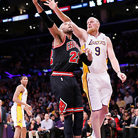 09 February 2014: Chicago Bulls power forward Taj Gibson (22) goes for the lay up past Los Angeles Lakers center Chris Kaman (9) during the Chicago Bulls 92-86 victory over the Los Angeles Lakers at the Staples Center, Los Angeles, California, USA.