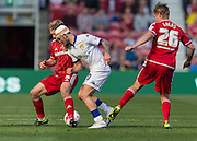 Leeds United FC midfielder Alex Mowatt  retains the ball under pressure from Middlesbrough FC midfielder Adam Clayton and Middlesbrough FC defender Tom?? Kalas during the Sky Bet Championship match between Middlesbrough and Leeds United at the Riverside Stadium, Middlesbrough, England on 27 September 2015. Photo by George Ledger.