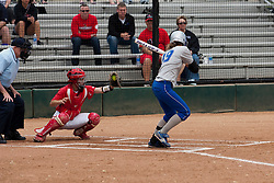 15 April 2012:  Sam West takes a pitch that is captured by Caiti Kopp during an NCAA women's softball game between the Drake Bulldogs and the Illinois State Redbirds on Marian Kneer Field in Normal IL