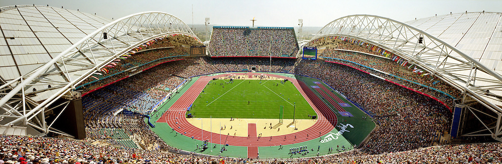 A panoramic view inside the Olympic Stadium during daytime competition of the Men's 400m Round 1 heat 4 during the Sydney Olympic Games 2000...Panoramic images from the Sydney Olympic Games, Sydney, Australia.  2000 . Photo Tim Clayton