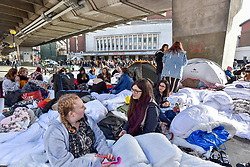 © Licensed to London News Pictures. 29/10/2017. London, UK.  Fans of singer, Harry Styles, queue up outside the Hammersmith Eventim Apollo in West London ahead of his first UK solo shows taking place on 29 and 30 October.  Many fans, eager to secure a space as close to the stage as possible have queued overnight, sleeping on the pavement in their sleeping bags or under duvets.  Fans immediately outside the entrance to the venue will be seeing the singer perform on the 29 October, whilst those under the nearby Hammersmith flyover (pictured) have arrived a day early with tickets for 30 October.  Photo credit: Stephen Chung/LNP