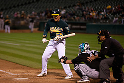 June 28, 2011; Oakland, CA, USA; Oakland Athletics designated hitter Hideki Matsui (55) reacts after striking out against the Florida Marlins during the eighth inning at the O.co Coliseum. Oakland defeated Florida 1-0.