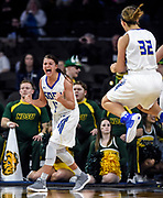 South Dakota State's Macy Miller (12) celebrates the basket after a foul call as teammate Sydney Palmer (32) also celebrates during a game against North Dakota State University in the first round of the Summit League Tournament on Saturday at the Denny Sanford Premier Center in Sioux Falls. (Matt Gade / Republic)