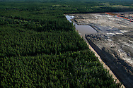 Oil industry expansion in Alberta's boreal forest near Fort Mc Murray.  A newly deforested area to become a drilling area for deep oil sands.  June 2008. ©Etienne de Malglaive.