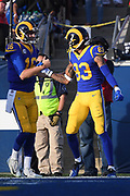 Dec 30, 2018; Los Angeles, CA, USA; Los Angeles Rams wide receiver Josh Reynolds (83) celebrates scoring a touchdown with Los Angeles Rams quarterback Jared Goff (16) at Los Angeles Memorial Coliseum. The Rams defeated the 49ers 48-31.  (Robin Alam/Image of Sport)