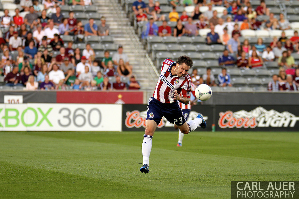 August 18th, 2012: Chivas USA defender Danny Califf (23) heads the ball to the ground in the first half against the Colorado Rapids at Dick's Sporting Goods Park