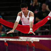 Emin Garibov, Russia, in action in the Men's Parallel Bars Final at North Greenwich Arena during the London 2012 Olympic games London, UK. 7th August 2012. Photo Tim Clayton