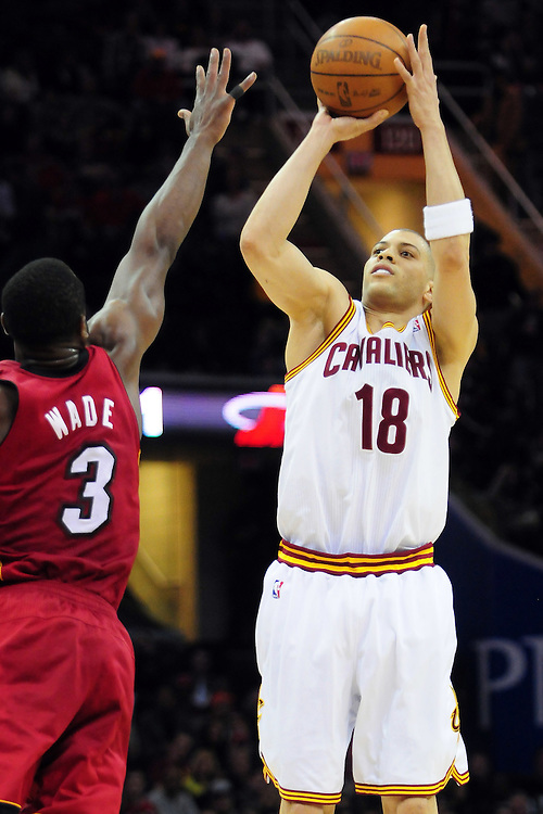 March 29, 2010; Cleveland, OH, USA; Cleveland Cavaliers shooting guard Anthony Parker (18) shoots over Miami Heat shooting guard Dwyane Wade (3) during the second quarter at Quicken Loans Arena. Mandatory Credit: Jason Miller-US PRESSWIRE