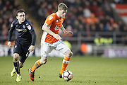Blackpool's Jim McAlister (4) gets away from Barnsley's Josh Scowen (6) during the The FA Cup 3rd round match between Blackpool and Barnsley at Bloomfield Road, Blackpool, England on 7 January 2017. Photo by Craig Galloway.