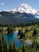 Hike to a view of Eunice Lake and Mount Rainier (14,411 feet) on the Tolmie Peak (5939 feet) trail in Mount Rainier National Park, Washington, USA.