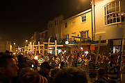 Crosses marking the death of 17 Protestant martyrs in 1556 being carried through the streets of Lewes, 5/11/05
