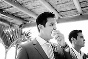 The groom reacts to the bride coming down the aisle at their destination wedding in Puerto Vallarta.  Image by Maine Wedding Photographer, Puerto Vallarta Wedding Photographer, New York City Wedding Photographer and Philadelphia Wedding Photographer Michelle Turner.