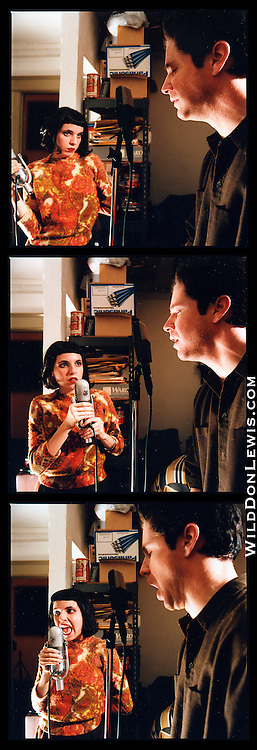 "Nora Keyes (L) and Greg Gomberg (R) record vocals for The Centimeters ""The Facts of Destiny"" album in Tom Grimley's apartment studio at the American Hotel, downtown Los Angeles, CA, Jan. 2, 1999."