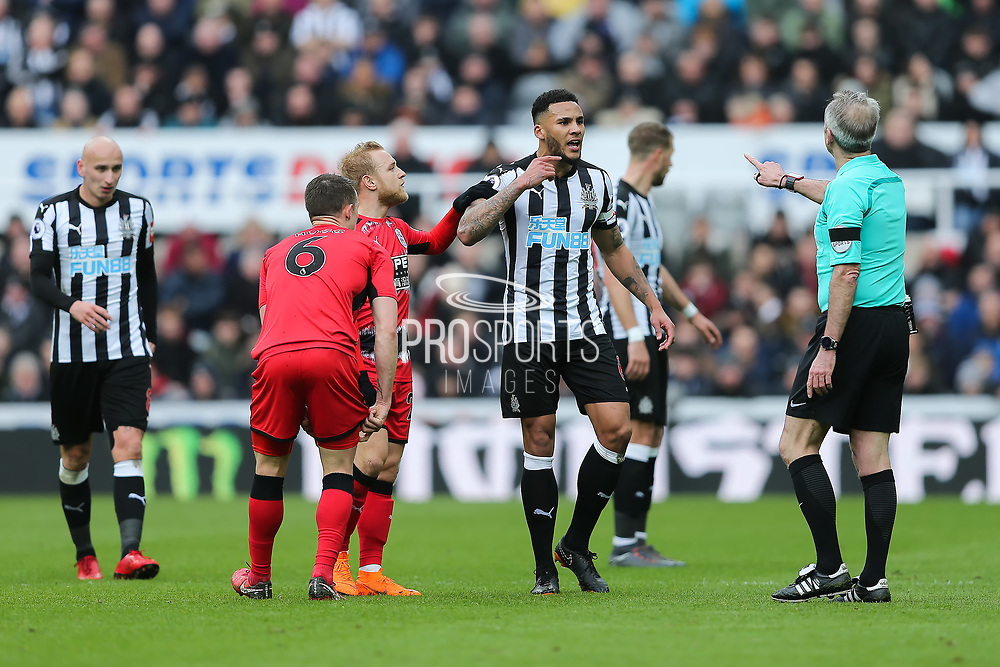 Jamaal Lascelles (#6) of Newcastle United questions a refereeing decision with referee Martin Atkinson during the Premier League match between Newcastle United and Huddersfield Town at St. James's Park, Newcastle, England on 31 March 2018. Picture by Craig Doyle.