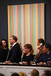 © Licensed to London News Pictures. 26/06/2019. LONDON, UK. ''Bright Shade'' by Bridget Riley, (Est. £600,000 - 800,000) sold for a hammer price of £880,000 at Sotheby's Contemporary Art Evening Sale in their New Bond Street galleries.  Photo credit: Stephen Chung/LNP