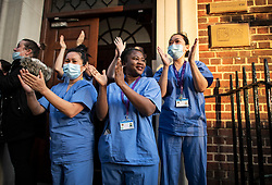 © Licensed to London News Pictures. 14/05/2020. London, UK. Medical staff at St Mary's Hospital in Paddington, West London take part in 'Clap For Our Carers' by applauding NHS workers, carers and key workers. Government has announced a series of measures to slowly ease lockdown, which was introduced to fight the spread of the COVID-19 strain of coronavirus. Photo credit: Ben Cawthra/LNP