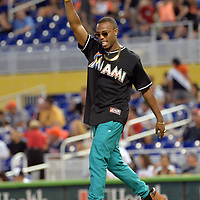 May 31, 2014; Miami, FL, USA; Recording artist B.o.B reacts prior to throwing out the first pitch before a game between the Atlanta Braves and the Miami Marlins at Marlins Ballpark. Mandatory Credit: Steve Mitchell-USA TODAY Sports