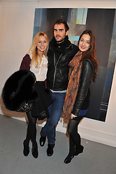 Left to right, KATHERINE HOLMGREN, OSCAR HUMPHRIES and ARIANNE LOVELACE at a Contemporary Art evening hosted by NUBA Art Ltd entitles 'It's a Material World' held at London West Bank Gallery, 133-137 Westbourne Grove, London W11 on 1st December 2011.