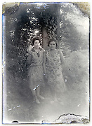 eroding glass plate with two adult female standing