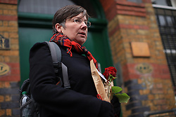 "© Licensed to London News Pictures . 11/03/2014. Sara Friday, a former train driver and  member of the RMT brings flowers to the RMT head office, London, to paid tribute to Bob Crow, General secretary of the Rail Maritime and Transport union, who has died today (11/03/14) at the age of 52 of a heart attack. Her note reads: ""You were a great leader, great public coacher. You could  really speak to the working class. You will be missed. Sara Friday."" London, UK.   Photo credit: Isabel Infantes /LNP"