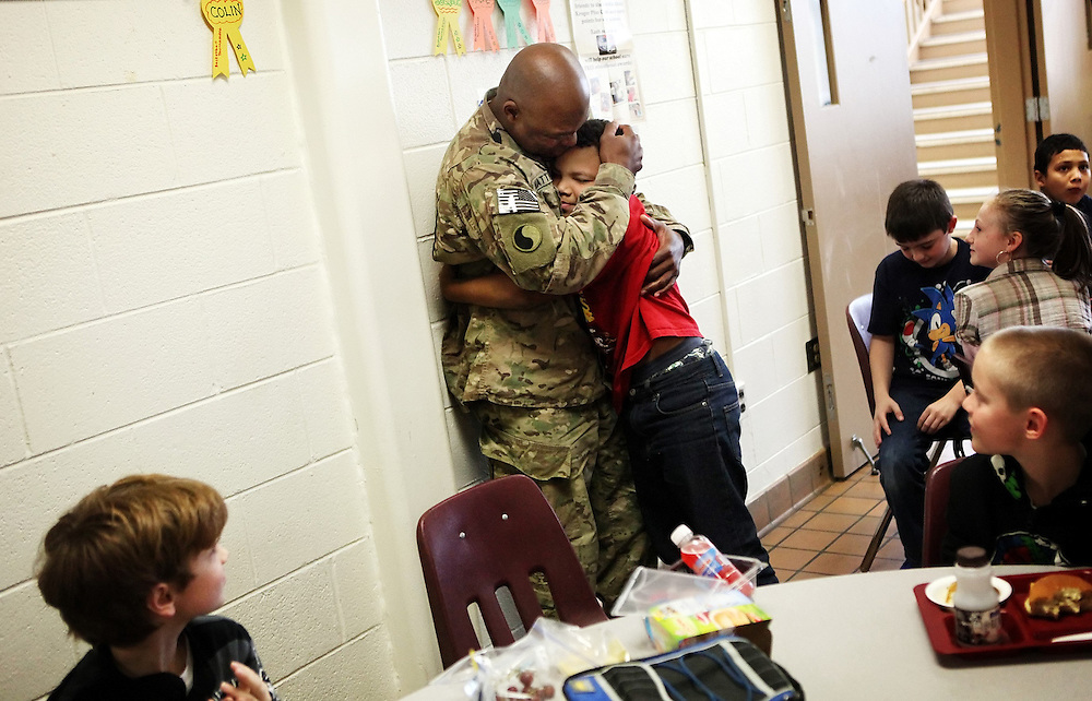 Kyle Green | The Roanoke Times<br /> 1/12/2012 Fourth grade student at W.E. Cundiff Elementary School, Dominic Matthews (right, age 10), reacts after he was surprised during lunch period by his dad, Deon Matthews, who just got back from serving in the Army in Afghanistan.