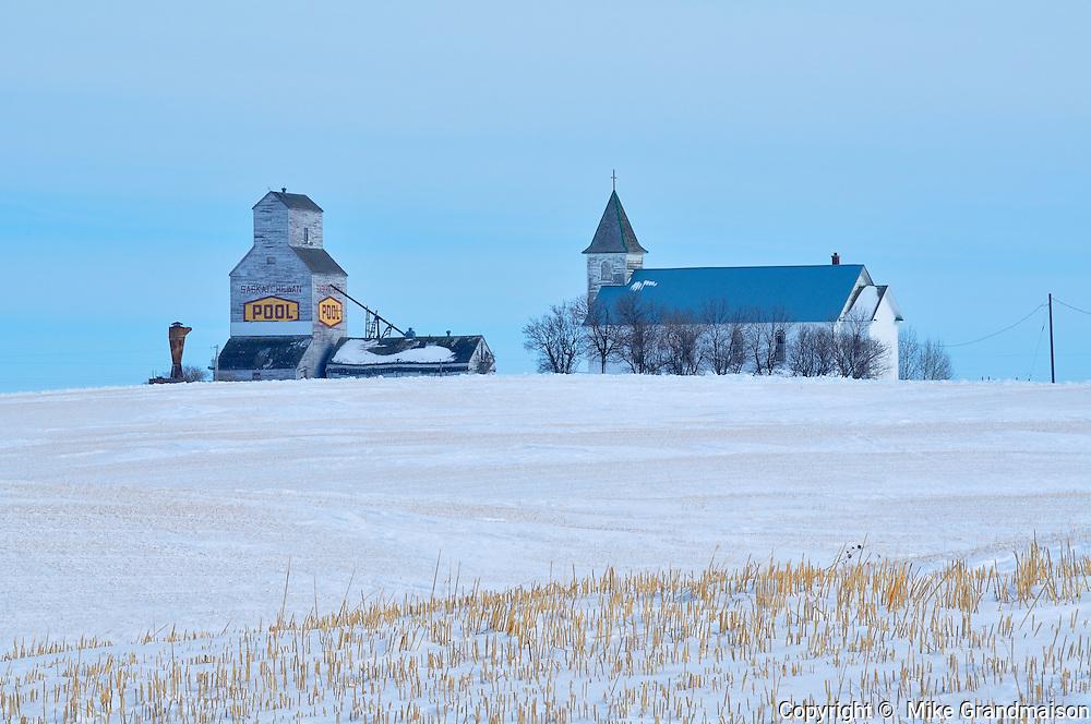 Grain elevator and church in winter<br /> Horizon<br /> Saskatchewan<br /> Canada