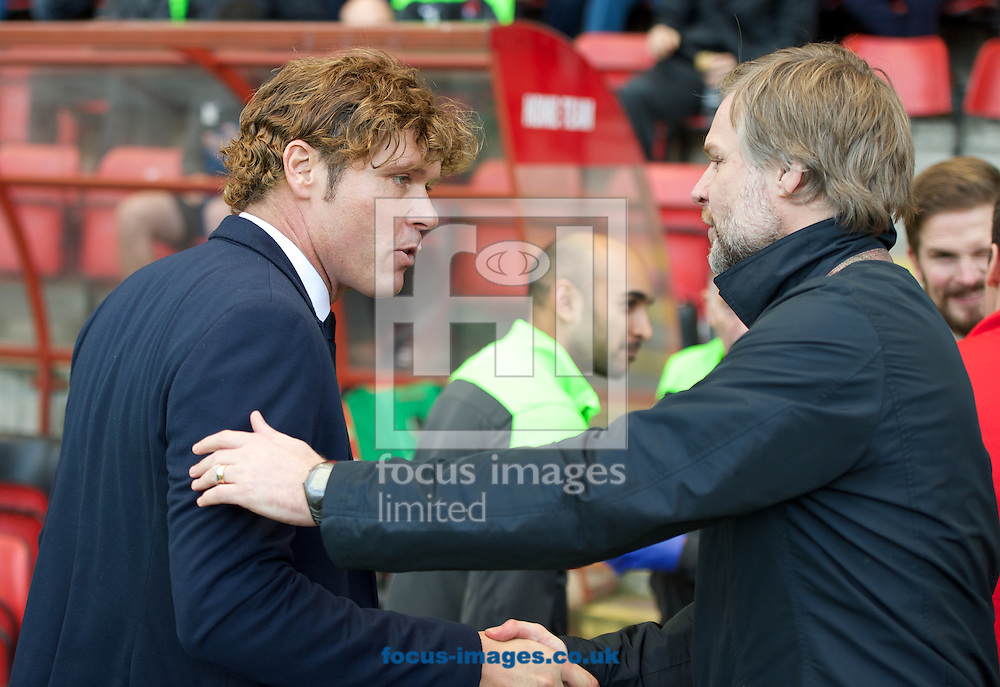 Manager Mauro Milanese of Leyton Orient  shakes hands with Manager Steven Pressley (right) of Coventry City before the Sky Bet League 1 match at the Matchroom Stadium, London<br /> Picture by Alan Stanford/Focus Images Ltd +44 7915 056117<br /> 01/11/2014