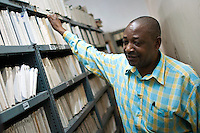 "Bruno Nanguka, known as ""The Librarian"", joined Radio Tanzania back in 1974, slowly working his way up to the role of Head of Library Services for the Tanzania Broadcast Corporation. His knowledge of the archives, and the groups who recorded them, is unmatched. Despite most of the archives not being catalogued, he knows where to find every last recording. Yet he is the only one. ""My colleagues, they have died or gone away. It's just me"", he says, highlighting the pressing need for preservation."