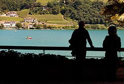 THEMENBILD - Touristen blicken auf den See, aufgenommen am 22. Mai 2017, Kalterer See, Kaltern, Italien // Tourists look on the Lake Caldaro, Kaltern, Italy on 2017/05/22. EXPA Pictures © 2017, PhotoCredit: EXPA/ JFK