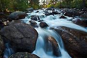 A rushing stream cascades through Rocky Mountain national Park, Colorado