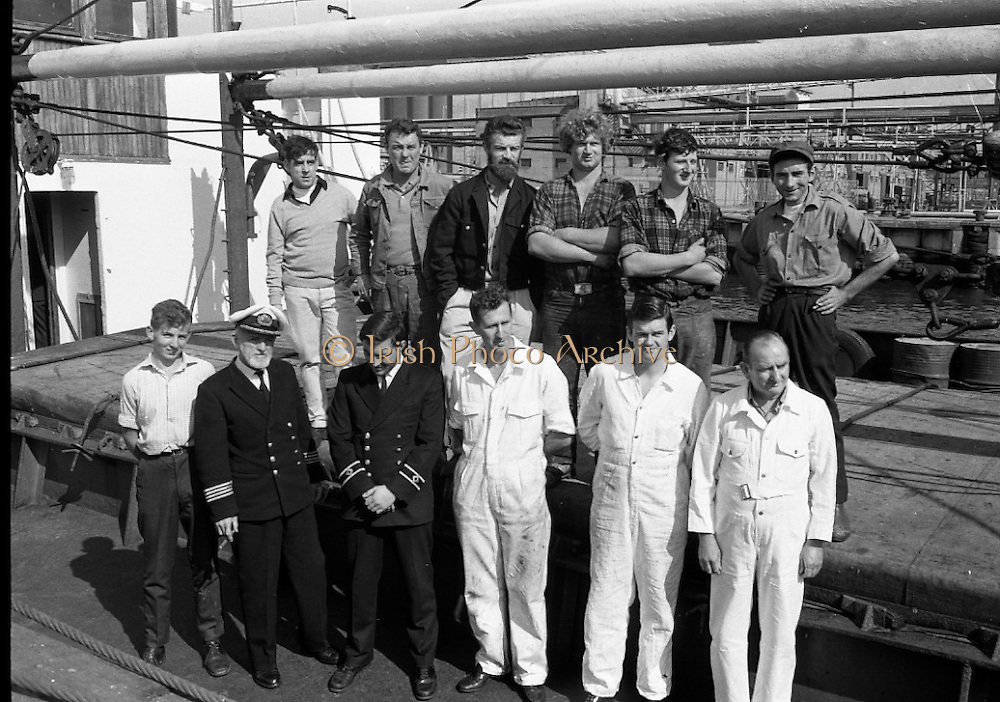 With her cargo of 600 tonnes of foodstuff, drugs and blankets for famine ridden Biafra, the Irish mercy ship Columcille sails out of Dublin, with Captain P. O'Saeghdha in command and a crew of 12, among which is a seaman priest, Rev. Fr. Joseph Fitzgibbon, the Limerick born Holy Ghost Father, who has volunteered as third engineer on the vessel.<br /> The crew of the vessel with their Captain.<br /> 06.09.1968