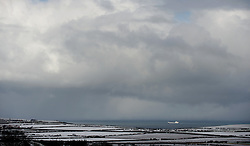 © Licensed to London News Pictures. 13/03/2013..North Yorkshire, England..A cargo ship makes its way towards Teesside and into a heavy snow storm as heavy snow falls over North Yorkshire as the wintery weather continues...Photo credit : Ian Forsyth/LNP