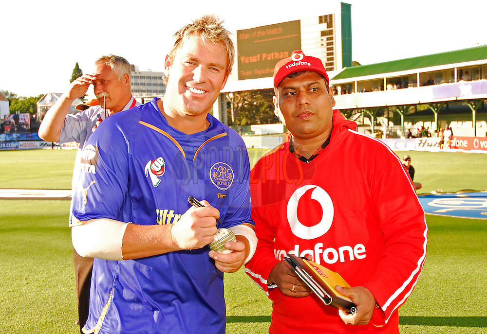 PORT ELIZABETH, SOUTH AFRICA - 2 May 2009.  Shane Warne signing the ball during the  IPL Season 2 match between the Deccan chargers vs Rajasthan Royals held at St Georges Park in Port Elizabeth , South Africa.