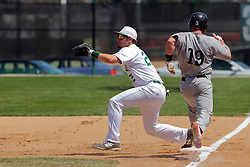 17 April 2016:  Chris Hill hustles to 1st but Tim Smyk grabs the put out throw during an NCAA division 3 College Conference of Illinois and Wisconsin (CCIW) Pay in Baseball game during the Conference Championship series between the North Central Cardinals and the Illinois Wesleyan Titans at Jack Horenberger Stadium, Bloomington IL