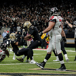 Dec 24, 2017; New Orleans, LA, USA; New Orleans Saints defensive end Cameron Jordan (94) celebrates with free safety Marcus Williams (43) after stopping Atlanta Falcons running back Devonta Freeman (24) on a fourth down play during the fourth quarter at the Mercedes-Benz Superdome. The Saints defeated the Falcons 23-13. Mandatory Credit: Derick E. Hingle-USA TODAY Sports