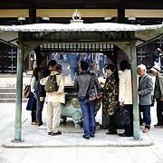 People lighting incense at Zen Buddhist temple Nanzen-ji (南禅寺) in Kyoto, Japan, founded in 1291