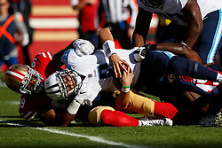 SANTA CLARA, CA - DECEMBER 17: Quarterback Marcus Mariota #8 of the Tennessee Titans is sacked by defensive tackle DeForest Buckner #99 of the San Francisco 49ers during the first quarter at Levi's Stadium on December 17, 2017 in Santa Clara, California.  (Photo by Jason O. Watson/Getty Images) *** Local Caption *** Marcus Mariota; DeForest Buckner