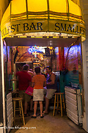 Worlds smallest bar on Duval Street at night in Key West, Florida, USA