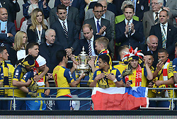 His Royal Highness, Prince William hands over the FA Cup trophy to Arsenal's Mikel Arteta and Arsenal's Per Mertesacker - Photo mandatory by-line: Dougie Allward/JMP - Mobile: 07966 386802 - 30/05/2015 - SPORT - Football - London - Wembley Stadium - Arsenal v Aston Villa - FA Cup Final