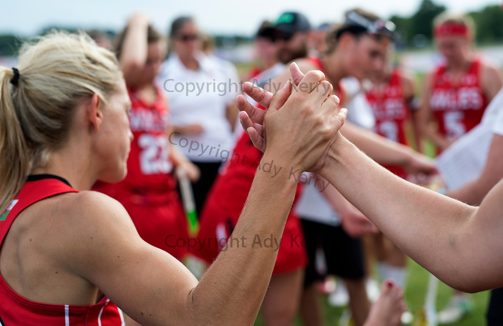 Wales' Laura Warren dutring half time at the 2017 FIL Rathbones Women's Lacrosse World Cup, at Surrey Sports Park, Guildford, Surrey, UK, 18th July 2017.