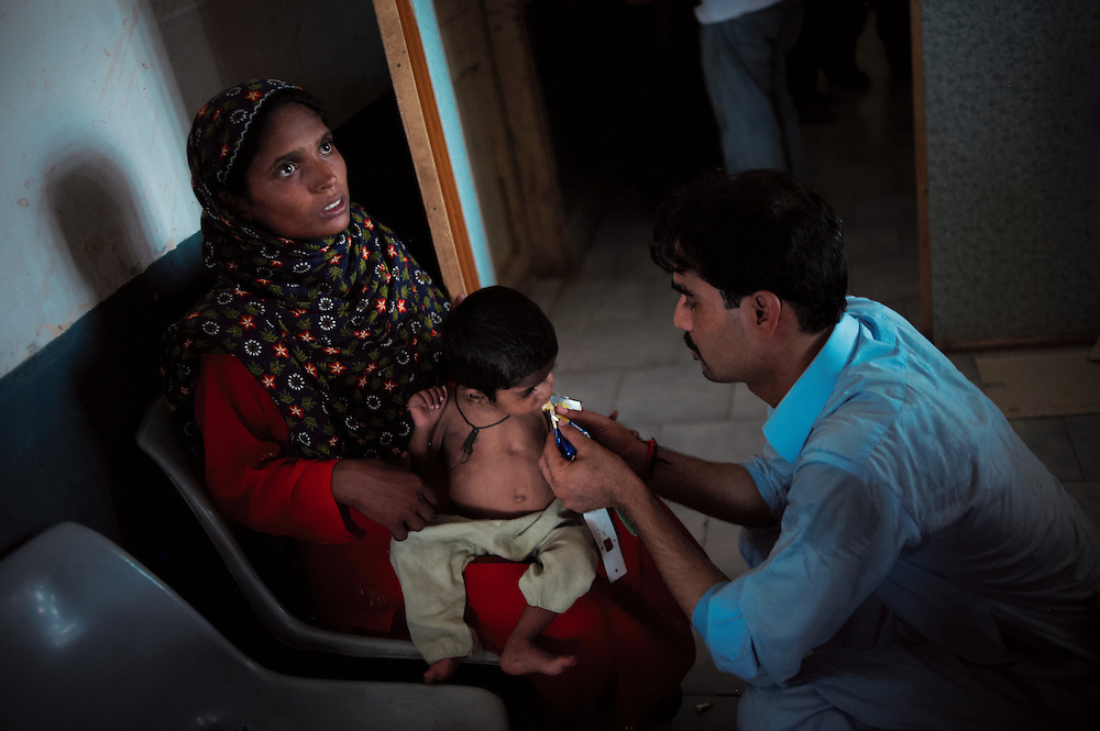 Razia Mahboob with child Javid Mahboob in the Bautoro District Hospital, Thatta, Sindh, Pakistan on July 1, 2011. Muhammad is 18 months old and treated for malnutrition. Razia is pregrant.