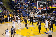 Golden State Warriors guard Klay Thompson (11) shoots a free throw against the Indiana Pacers at Oracle Arena in Oakland, Calif., on December 5, 2016. (Stan Olszewski/Special to S.F. Examiner)