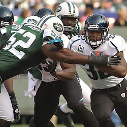 Nov 15, 2009; East Rutherford, NJ, USA; New York Jets linebacker David Harris (52) grabs Jacksonville Jaguars running back Maurice Jones-Drew (32) during first half NFL action between the New York Jets and Jacksonville Jaguars at Giants Stadium.