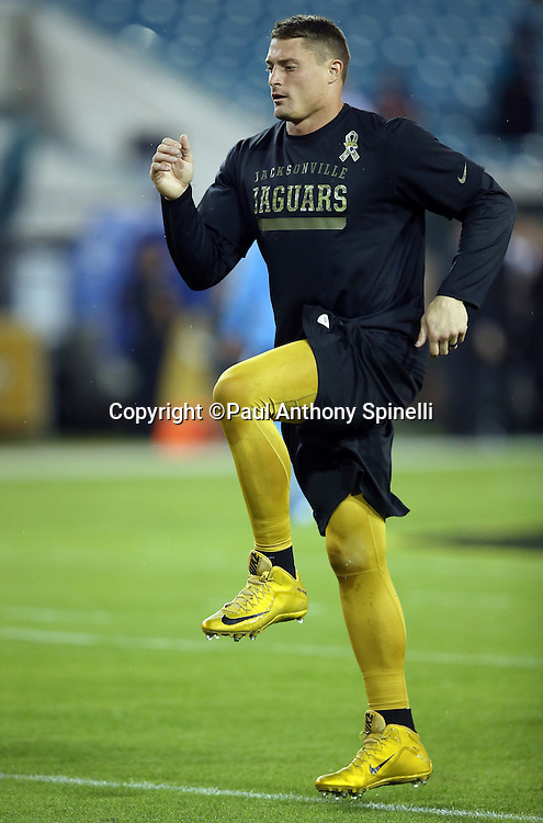Jacksonville Jaguars middle linebacker Paul Posluszny (51) high steps as he warms up before the 2015 week 11 regular season NFL football game against the Tennessee Titans on Thursday, Nov. 19, 2015 in Jacksonville, Fla. The Jaguars won the game 19-13. (©Paul Anthony Spinelli)