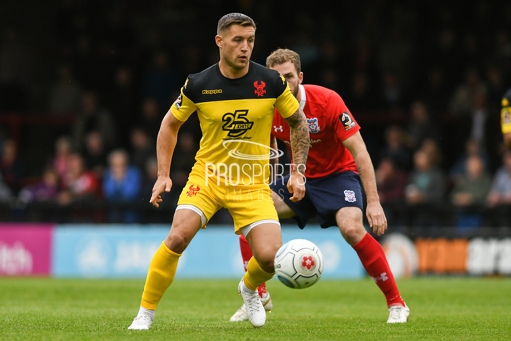 Lee Vaughan of Kidderminster Harriers (2) lays the ball off during the Vanarama National League match between York City and Kidderminster Harriers at Bootham Crescent, York, England on 15 September 2018.