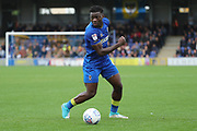AFC Wimbledon defender Deji Oshilaja (4) dribbling during the EFL Sky Bet League 1 match between AFC Wimbledon and Rochdale at the Cherry Red Records Stadium, Kingston, England on 30 September 2017. Photo by Matthew Redman.