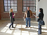 Kelly Bemus (from left) of Skogman Realty shows an unfinished unit to Dennis Mochal and Barb Mochal of Olatha, Kansas at Bottleworks Loft Condominiums, 905 3rd St. SE in Cedar Rapids on Saturday, February 18, 2012. (Stephen Mally/Freelance)