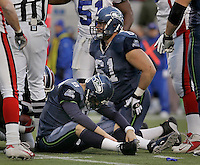 Seattle Seahawks Matt Hasselbeck holds his head down as center Robbie Tobeck stands up after Hasselbeck fumbled the ball which Buffalo recovered in the fourth quarter of the game at Qwest Field in Seattle, November 28, 2004.
