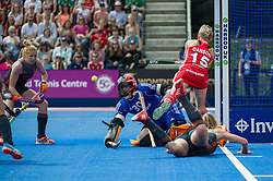 The The Netherlands Julia Remmerswaal saves from Alex Danson of England. England v The Netherlands, Lee Valley Hockey and Tennis Centre, London, England on 11 June 2017. Photo: Simon Parker